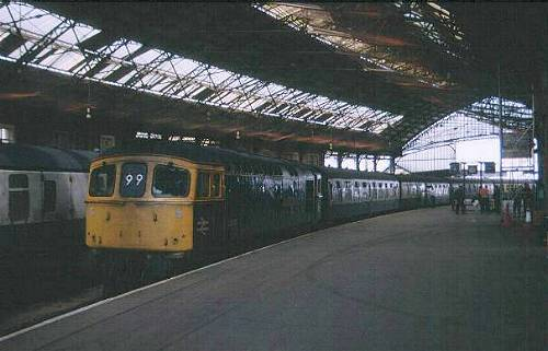 B.T.M- 33027 on the 8.30 Brighton-Cdf awaits removal of stock before releasing into spur