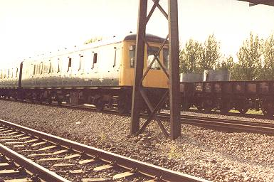 A truly aweful shot of a dmu passing Magor, 1981.