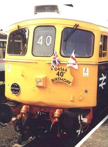 33048 adorned with celebratory decorations 25th Aug 2001 Minehead