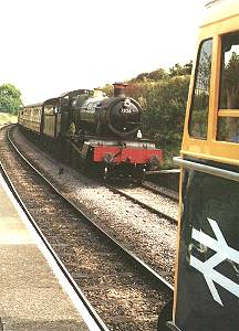 33048 waits at the passing point of Blue Anchor as 7828 'Odney Manor' pulls in